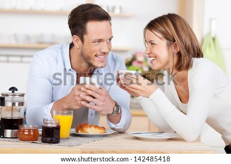 Getting ready for the day with a morning coffee and breakfast - stock photo
