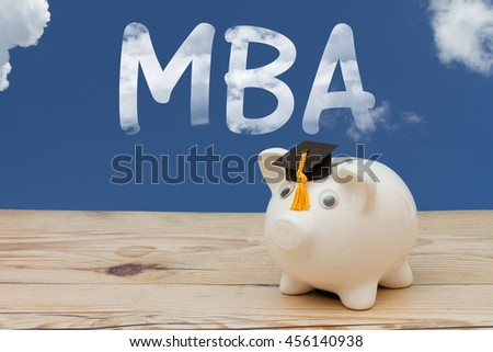 Getting your MBA, A white piggy bank with grad cap on weathered wood with sky background with text MBA - stock photo