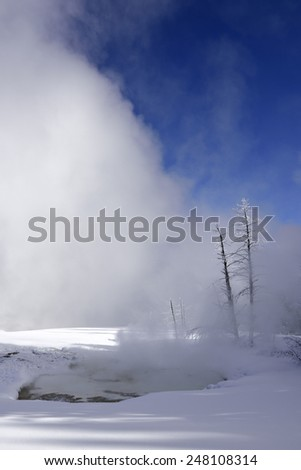 Geyser covered with snow in Yellowstone National Park,  - stock photo