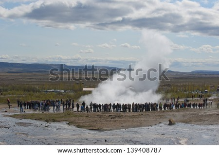 Geyser eruption in Iceland while blowing water