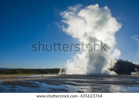 Geyser thermals Yellowstone National Park beautiful morning sun lit steaming erupting mist - stock photo