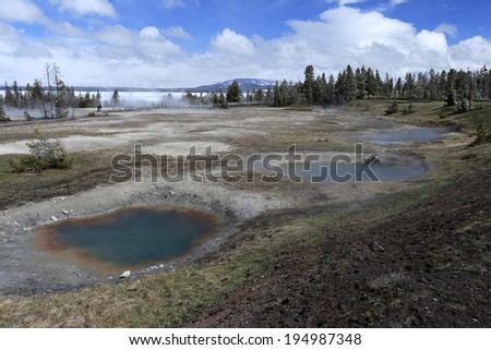 Geyser with natural surrounding, Yellowstone national Park, USA - stock photo