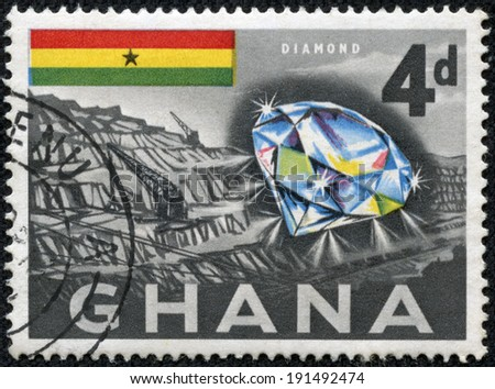 GHANA - CIRCA 1959: A stamp printed in Ghana shows a diamond and mine, circa 1959. - stock photo
