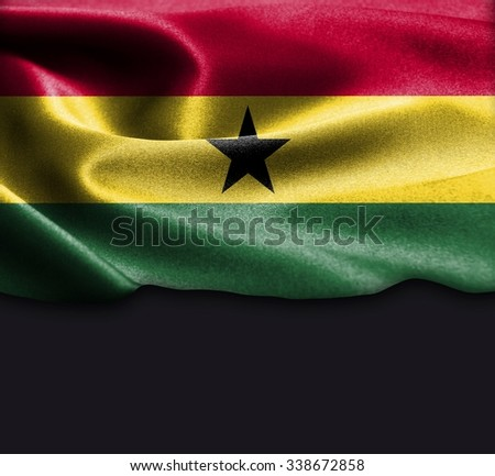 Ghana flag on smooth silk texture Dark Background Space for Text - stock photo