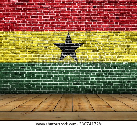 Ghana flag painted on brick wall with wooden floor - stock photo