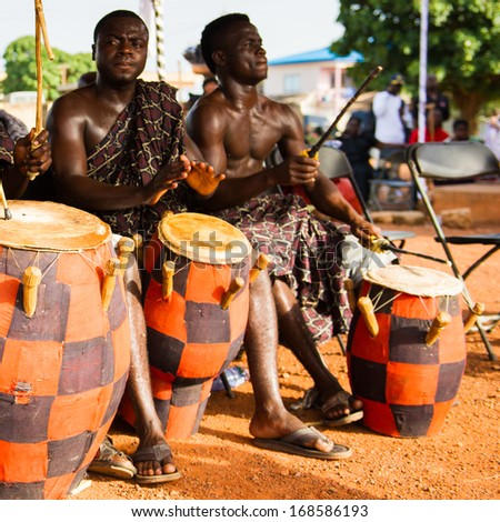 GHANA - MARCH 3, 2012: Unidentified Ghanaian local musicians make the traditional African sounds with the drums in Ghana, on March 3rd, 2012. Music is the main kind of entertainment in Africa