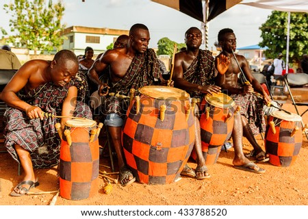 GHANA - MARCH 3, 2012: Unindentified Ghanaian local musicians make the traditional African sounds with the drums in Ghana, on March 3rd, 2012. Music is the main kind of entertainment in Africa