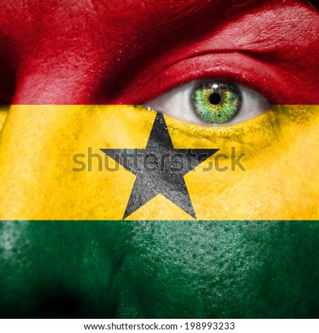 Ghanaian flag painted on a man's face to show support for Ghana