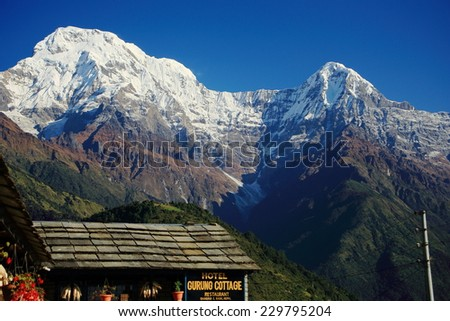 GHANDRUK, NEPAL - OCTOBER 11: The Gurung Cottage Hotel offers accommodation at the foot of the Annapurna South peak on October 11, 2012 in Ghandruk village-Kaski distr.-Gandaki zone-Nepal.  - stock photo