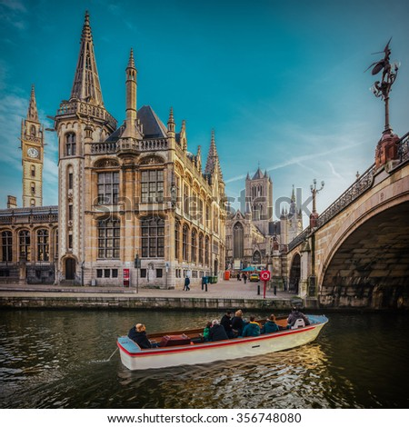 Ghent, Belgium, as visited from the boat, with film emulation colors and contrast, as well as high resolution panorama in square format for large prints - stock photo