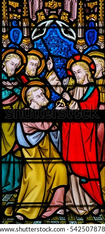 GHENT, BELGIUM - DECEMBER 23, 2016: Stained Glass window depicting Jesus giving the Keys to Heaven to Saint Peter, in the Cathedral of Saint Bavo in Ghent, Flanders, Belgium.