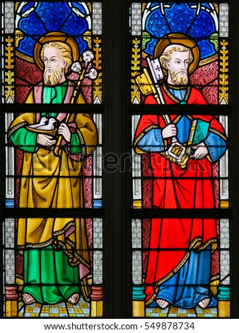 GHENT, BELGIUM - DECEMBER 23, 2016: Stained Glass window depicting Saint Joseph and Saint Peter in the Cathedral of Saint Bavo in Ghent, Flanders, Belgium.