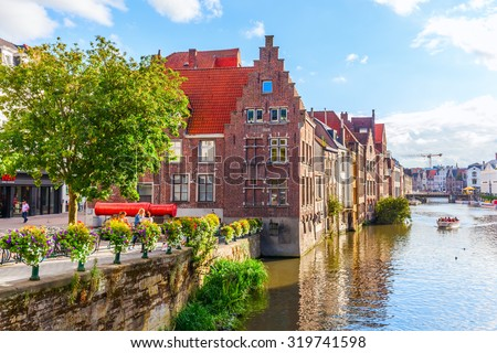 GHENT, BELGIUM - SEPTEMBER 02, 2015: canal in the old town of Ghent with unidentified people. With about 240,000 Ghent is Belgiums 2nd largest municipality by number of inhabitants  - stock photo