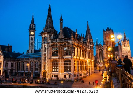 Ghent in Belgium at night. Medieval old part of the famous Flemish city which is held well preserved. Sant - Nicholas Church, bridge and The Graslei area. - stock photo
