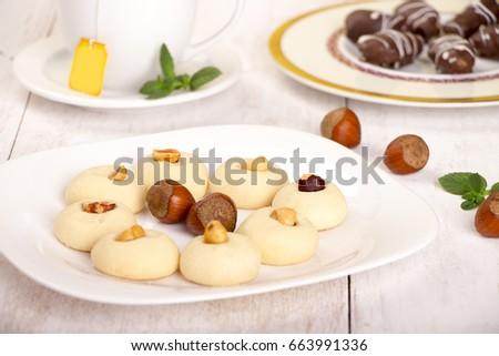 Popular Dessert Eid Al-Fitr Feast - stock-photo-ghorayeba-butter-cookies-with-nuts-and-cup-of-tea-for-eid-el-fitr-islamic-feast-663991336  HD_577060 .jpg