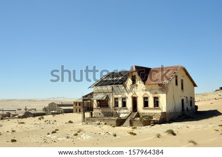 Ghost diamond mining town Kolmanskop near Luederitz, Namibia, Africa - stock photo