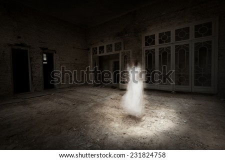 Ghost girl in white dress appears in an old room - stock photo