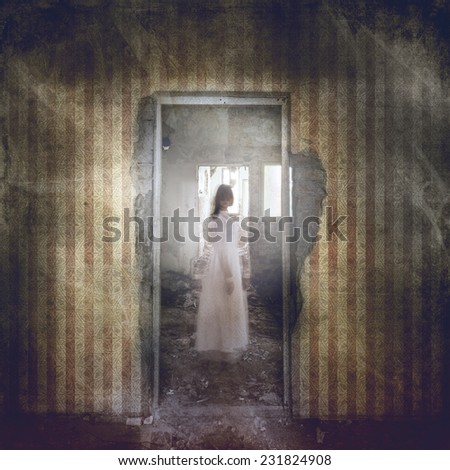 Ghost girl with twisted head in door frame in abandoned grunge building  - stock photo
