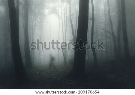 ghost in a spooky dark forest on halloween with grunge texture - stock photo