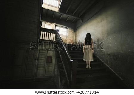Ghost in Haunted House, Mysterious Woman, Horror scene of scary woman's ghost.(Vintage Film Style Process) - stock photo