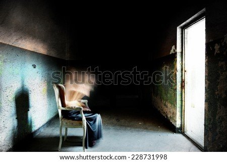 Ghost of a woman being rapture into the light - stock photo