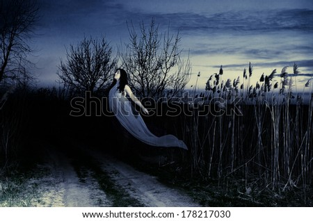 Ghost on a rural road. Evening