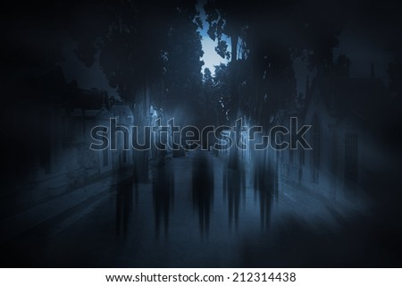 Ghosts passing on the main street of an old european cemetery on a foggy full moon night - stock photo