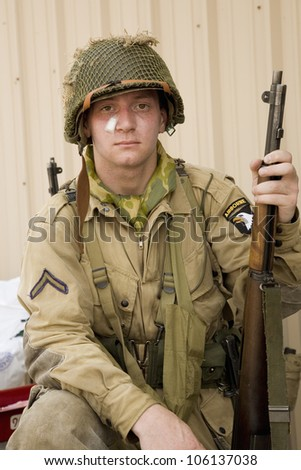 GI Joe Infantryman posing with rifle and authentic band aid at Mid-Atlantic Air Museum World War II Weekend and Reenactment in Reading, PA held June 18, 2008 - stock photo