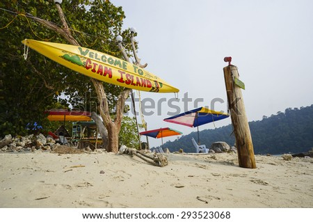 GIAM ISLAND - JULY 30 : Signboard of Giam Island at the Jetty on July 30, 2014 in Pangkor, Malaysia. Giam Island is one of the 2 smaller islands at Pangkor popular place to kayaking and snorkeling - stock photo