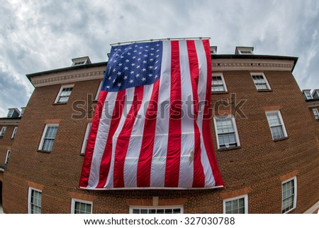 giant american star and stripes flag in alexandria city hall - stock photo