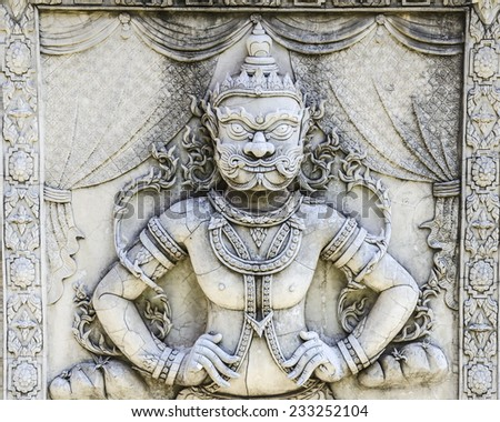 Giant bas-relief sculpture from Ramayana, one of the great Hindu epics. - stock photo