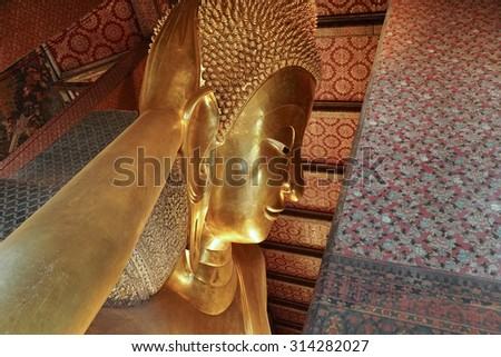 Giant Buddha inside Wat Pho Temple at Bangkok Province Asia Thailand, They are public domain or treasure of Buddhism, no restrict in copy or use