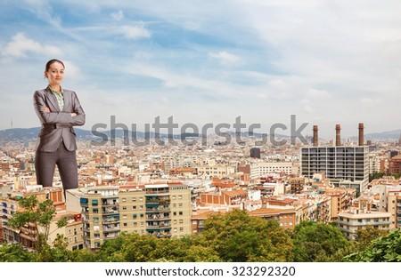 Giant businesswoman - stock photo