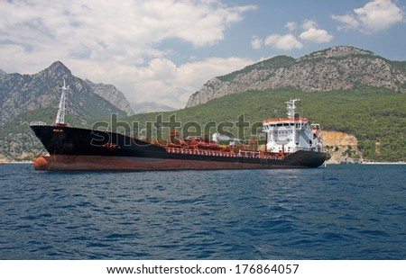 Giant cargo ship in front of Toros Mountain, Antalya.