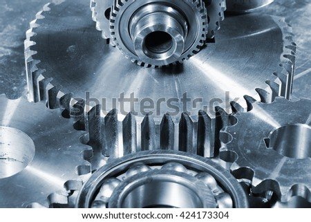 giant cogs and gears made of titanium and steel - stock photo