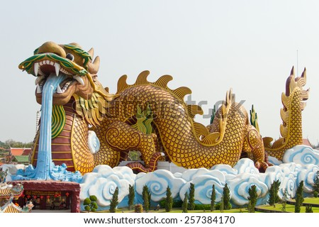 Giant dragon statue with blue sky and white clouds