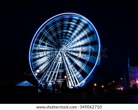 Giant ferris wheel in Gdansk by night, Poland - stock photo