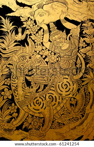 Giant fighting lion in traditional Thai style painting  on window of the temple - stock photo