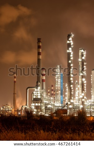 giant gas and oil pipelines at night