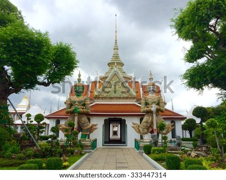 Giant Gatekeepers at Wat Arun - stock photo