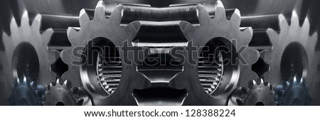 giant gears and cogwheels in a panoramic mirror concept, slight toning idea - stock photo