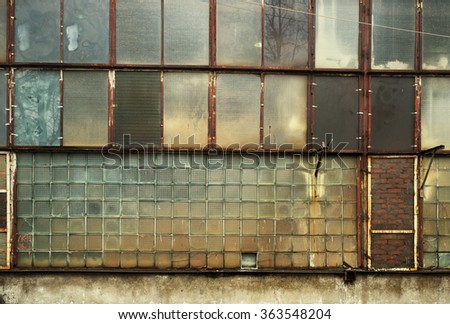 Giant glass wall. Rusty windows and frames. Industrial facility. Vintage effect. - stock photo
