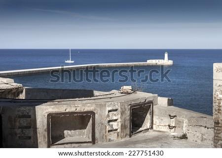 Giant gun trail on the entrance of Valletta - stock photo