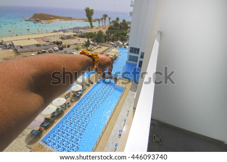 Giant hand in building a hotel - stock photo