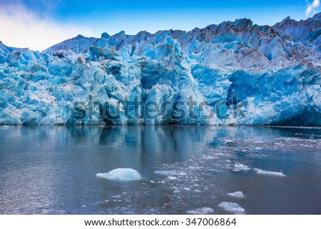 Giant icebergs and ice floes broken away from the shore of the glacier. Grey Lake in the national park Torres del Paine, Chile - stock photo
