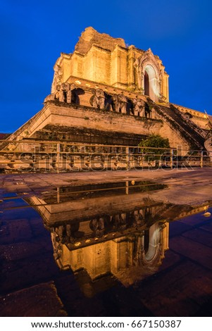 Giant pagoda reflecting in water, Wat Chedi Lung  oldest temple in Chiang Mai ,Thailand.