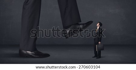 Giant person stepping on a little businessman concept on background - stock photo