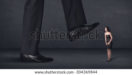 Giant person stepping on a little businesswoman concept on background - stock photo