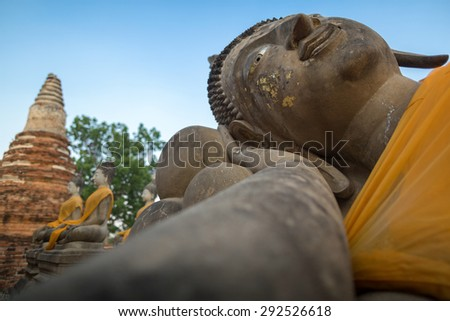 Giant reclinning Buddha in Phutthaisawan temple ,Ayuthaya province (Ancient City), Thailand with ruin pagoda and buddha images in the background. - stock photo