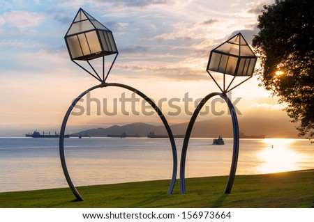 Giant rings at Sunset Beach, Vancouver - stock photo